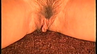 Yvonne shows you her hairy vag close up as she fingers it