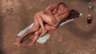 Sex on a public nudist beach filmed by voyeur