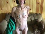 Thin inked granny showing off her pussy