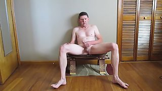 Stroking off while sitting on a stool