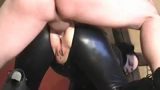 Hoe in latex outfit gets booty fucked from behind