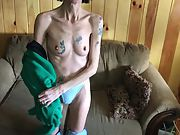 Skinny tattooed granny disrobing and showing her hairy cooter