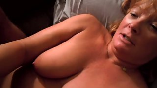 Mature wifey using both her hands to stroke the pecker squeezing it rigid