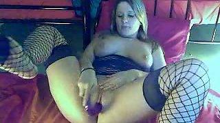Amateur in stockings masturbating