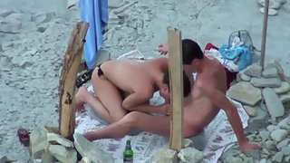 Shameless housewife couple oral hump at the beach